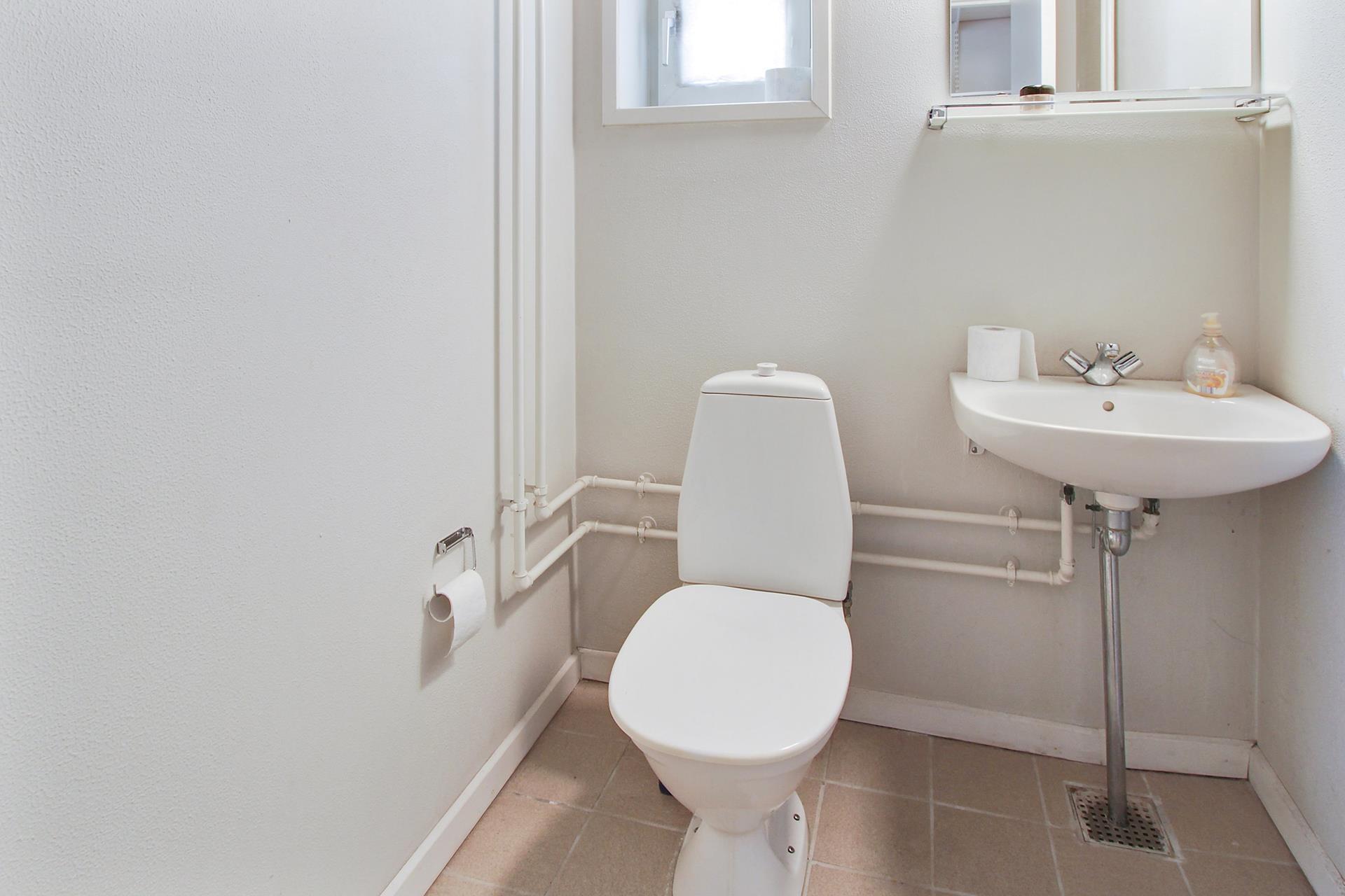 Detail på Skrågade i Nørresundby - Toilet